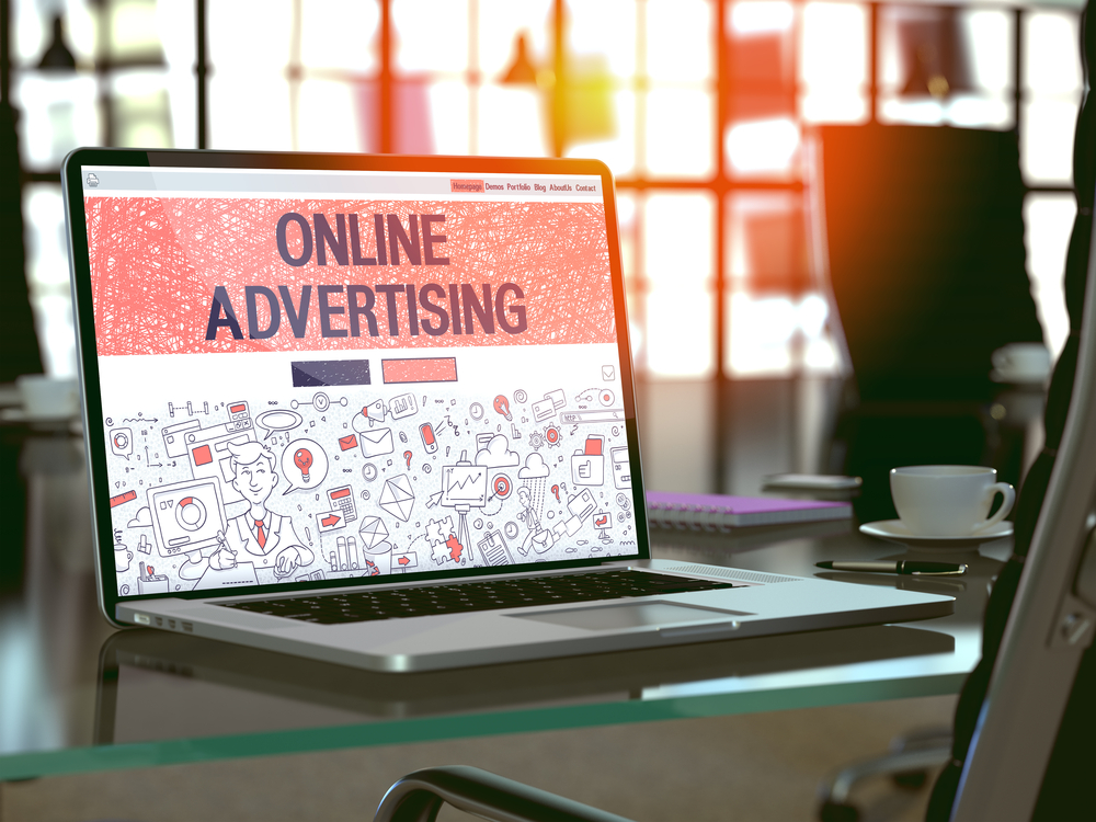 Online Advertising Concept. Closeup Landing Page on Laptop Screen in Doodle Design Style. On Background of Comfortable Working Place in Modern Office. Blurred, Toned Image. 3D Render.